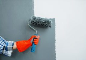 house painter hand with paint roller